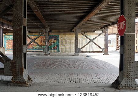 JOLIET, ILLINOIS / UNITED STATES - APRIL 12, 2015: Motorists and pedestrians may pass through the Washington Street viaduct in downtown Joliet.
