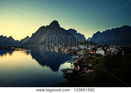 mist in sunset time Reine Village, Lofoten Islands, Norway