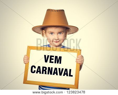 Little Funny girl in striped shirt with blackboard. Text  vem carnaval.  Isolated on gray background.