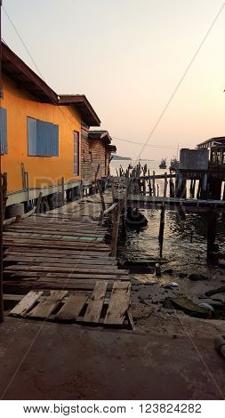 Old wooden bridge and sunset in the fisheries village