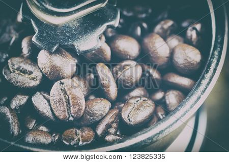 Closeup Of Coffee Beans With Focus Coffee Beans On Coffee Grinder,vintage Toning