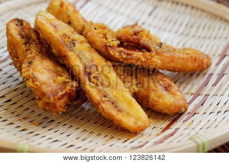 Close up of fried bananas on rattan tray. A traditional food in some places in south east asia.