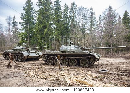 Soviet combat tank T55 at trainig ground in the forest