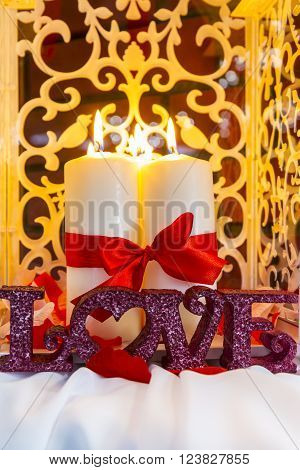 Romantic decorative burning candles on the table