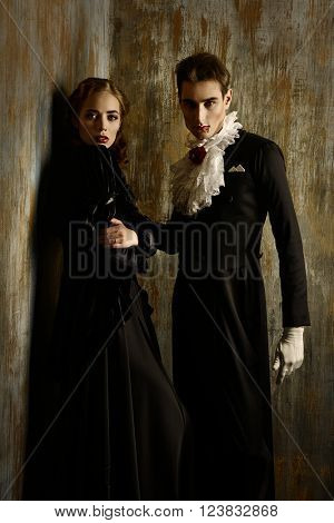 Beautiful couple of vampires dressed in medieval clothing. Halloween.