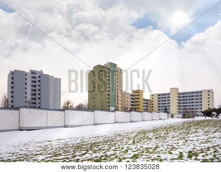High-rises on the snowy outskirts in winter