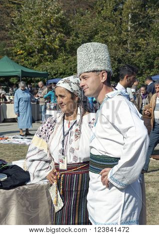 CHISINAU MOLDOVA- JULY 27 2014: A man and woman in traditional Moldovan costumes in Central Park on independence day.