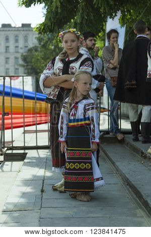 Children in Moldovan national costumes. The participants of the folk concert on the independence day in the Central square.