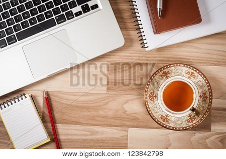 Picture of Office Stuff On Table Workplace with green tea, laptop, notepad, pencil