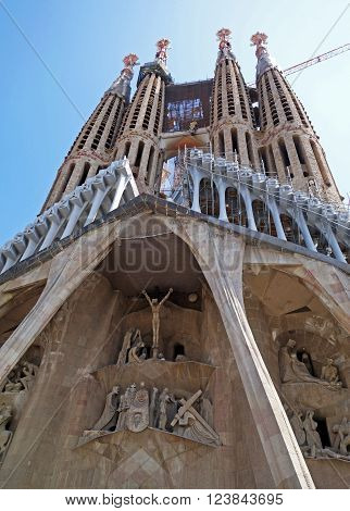 BARCELONA, SPAIN - JULY 31, 2015: View of the Passion facade of the basilica Sagrada Familia in Barcelona, Spain