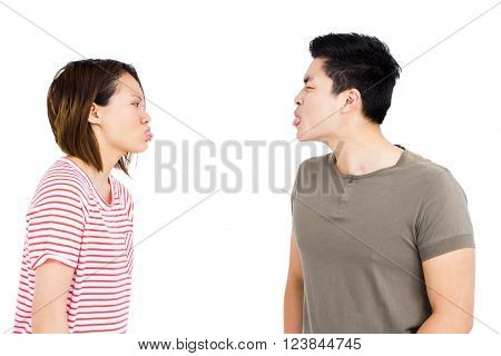 Young couple teasing each other on white background