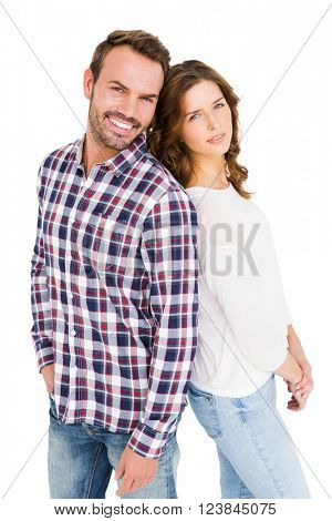 Happy young couple standing back to back on white back ground