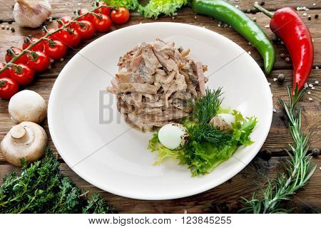 Restaurant food. Meat Salad served with dill and mayonnaise sauce. Served at wooden rustic background with vegetables.