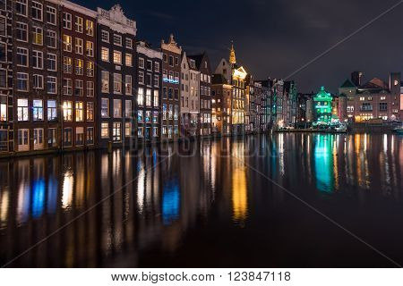 Amsterdam by night overlooking a canal and its characteristic houses