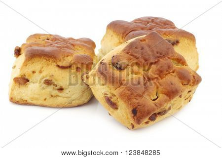traditional english scones with raisins on a white background