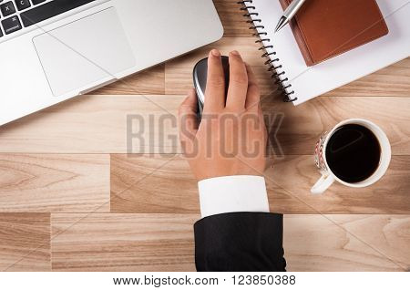 Holding mouse while working in office with other office stuffs