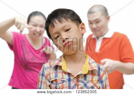 Young asian boy being scold by his parent