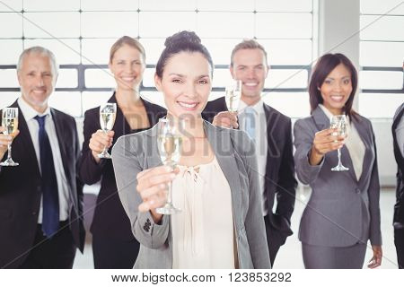 Portrait of business team holding champagne flute in the office