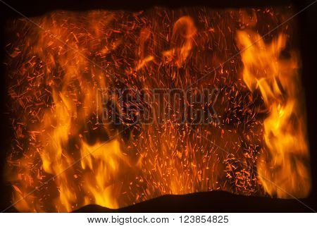 the flame inside a special furnace for burning sawdust