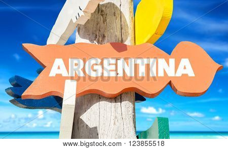Argentina signpost with beach background