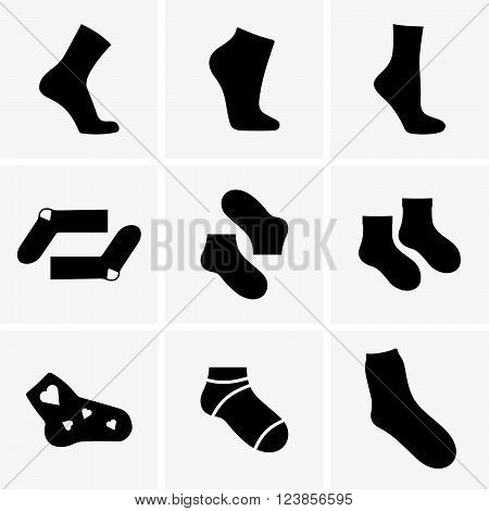Set of socks on grey background, shade pictures