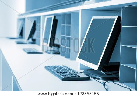 Computer neatly placed in a computer room
