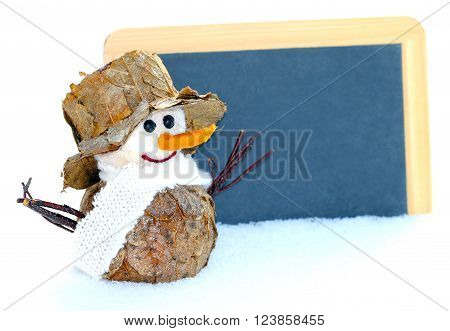 little snowman stands with a blackboard in the snow