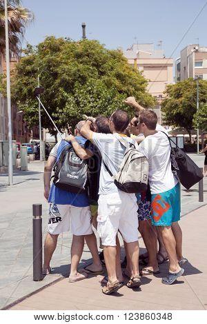 SPAIN, BARCELONA, JUNE, 27, 2015 - Happy friends taking a collective selfie in Barcelona, Spain