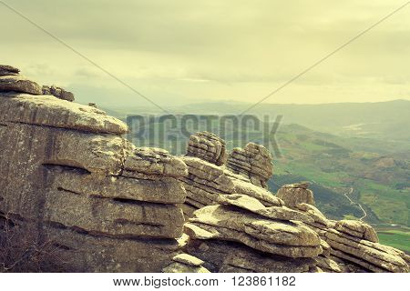View Of Karst Rocks With Farmlands In The Background. El Torcal, Antequera. Spain.