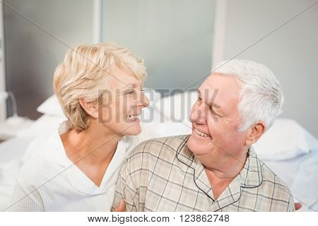 High angle view of happy senior couple in nightwear on bed