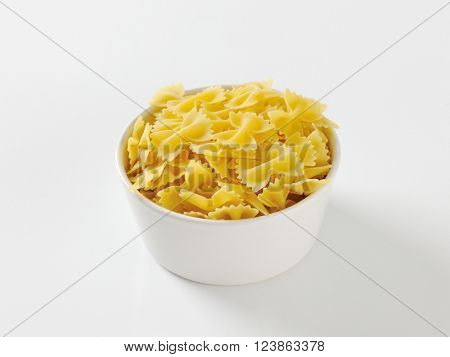 Bowl of uncooked farfalle pasta