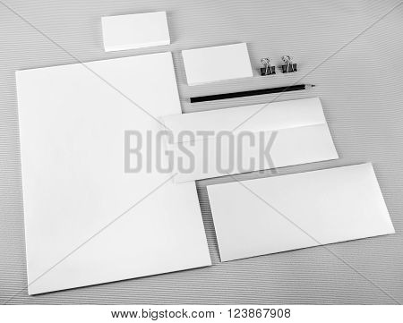 Photo of blank stationery set on gray background. Template for branding identity. Mock-up for ID. For design presentations and portfolios.