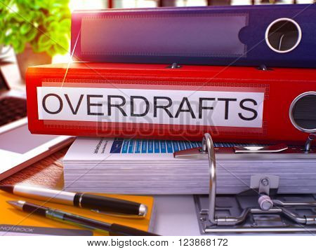 Red Office Folder with Inscription Overdrafts on Office Desktop with Office Supplies and Modern Laptop. Overdrafts Business Concept on Blurred Background. Overdrafts - Toned Image. 3D.