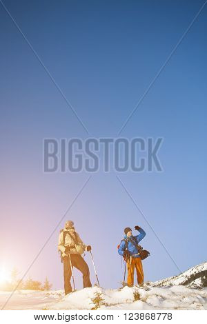 Two Climbers With Backpacks.