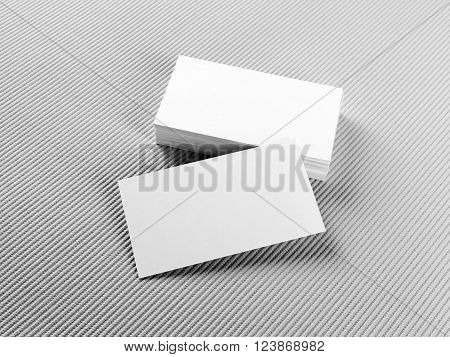 Blank business cards on gray background. Mockup for branding identity. Stack of blank business cards. Template for ID.