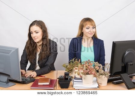 Two Office Employee, One Of Which Workplace Forced By Plants