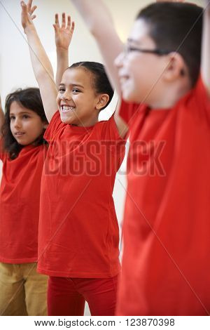 Group Of Children Enjoying Drama Class Together