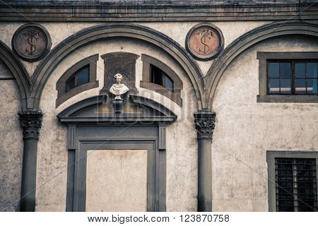 Archway with a statue above it in  florence italy