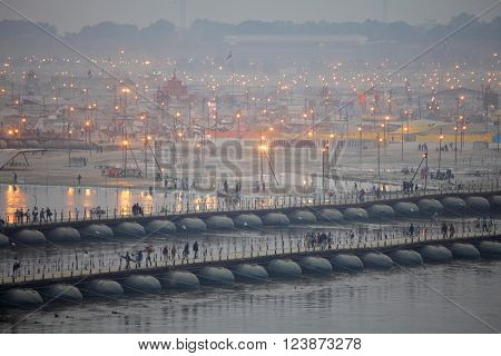ALLAHABAD, INDIA - FEBRUARY 06, 2013: Thousands of Hindu devotees crossing the pontoon bridges over the Ganges River at Maha Kumbh Mela festival in Allahabad, Indi