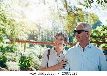 Happy Mature Couple Standing Together In A Park