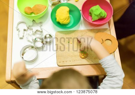 Creative young handsome kid playing with dough ** Note: Soft Focus at 100%, best at smaller sizes