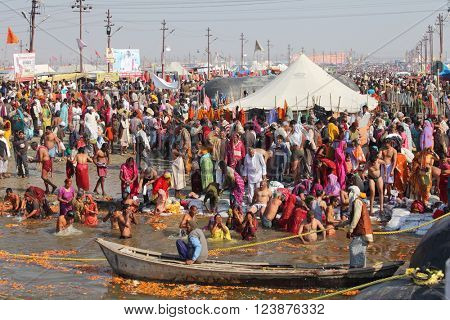 ALLAHABAD, INDIA - FEBRUARY 10, 2013: Thousands of Hindu devotees come to confluence of the Ganges and Yamuna River for holy dip during the festival Kumbh Mela. The world's largest religious gathering