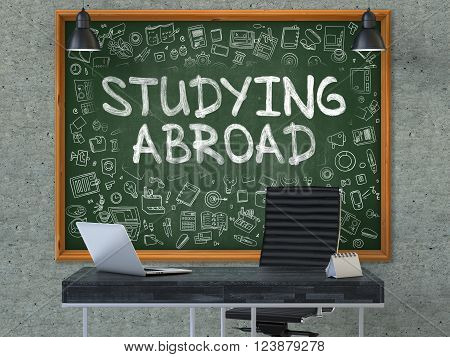Hand Drawn Studying Abroad on Green Chalkboard. Modern Office Interior. Gray Concrete Wall Background. Business Concept with Doodle Style Elements. 3D.