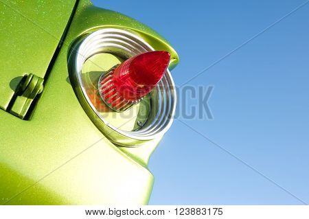 retro vehicle tail-light on a blue sky background