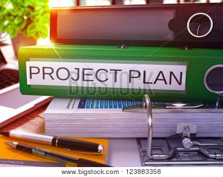 Project Plan - Green Ring Binder on Office Desktop with Office Supplies and Modern Laptop. Project Plan Business Concept on Blurred Background. Project Plan - Toned Illustration. 3D Render.