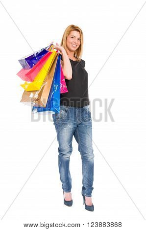 Funky and trendy shopping woman carrying shopping bags on the shoulder