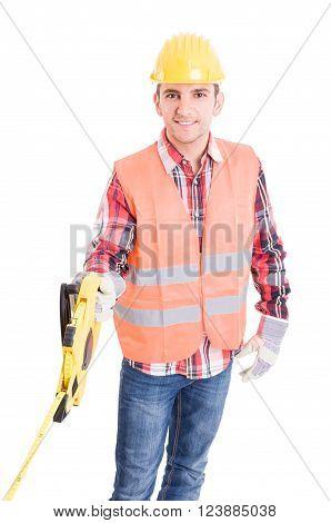 Professional Builder Unrolling An Industrial Meter Reel