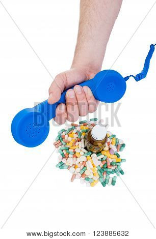 Order pills using phone concept with hand holding telephone and pills on white background
