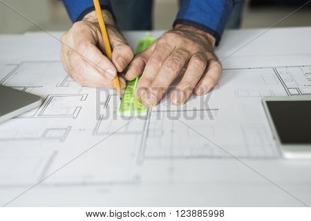 architect is working with blueprints, selective focus