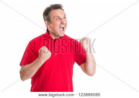 Excited football fan screaming or shouting with fists in the air